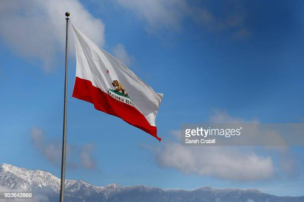 The California state flag are seen before the Monster Energy NASCAR Cup Series Auto Club 400 at Auto Club Speedway on March 18 2018 in Fontana...