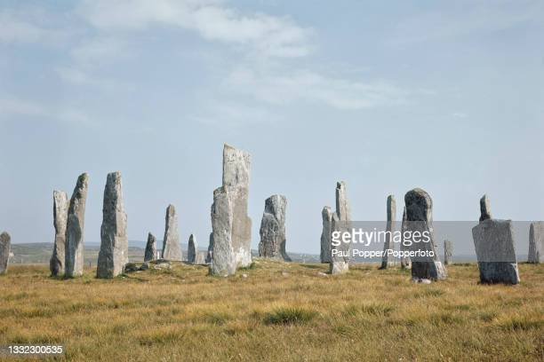The Callanish Stones, a circle of standing stones, erected in the late Neolithic era, located near the village of Callanish on the west coast of...