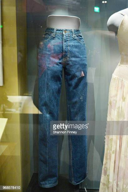 The Calvin Klein jeans worn by Oprah Winfrey on a 1988 episode of The Oprah Winfrey Show on display as part of the exhibition Watching Oprah The...