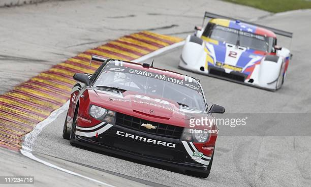 The Camaro of Jordan Taylor and Bill Lester leads during practice for the Road America 250 at Road America on June 24 2011 in Elkhart Lake Wisconsin