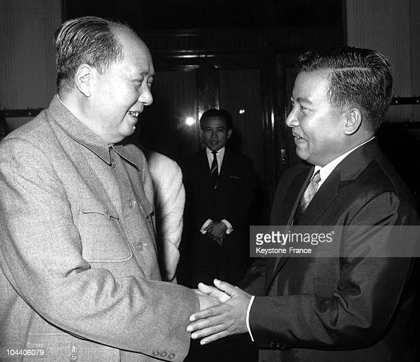 The Cambodian head of state NORODOM SIHANOUK shaking hands with MAO TSE TUNG, the President of the Chinese Communist Party and supreme leader of...