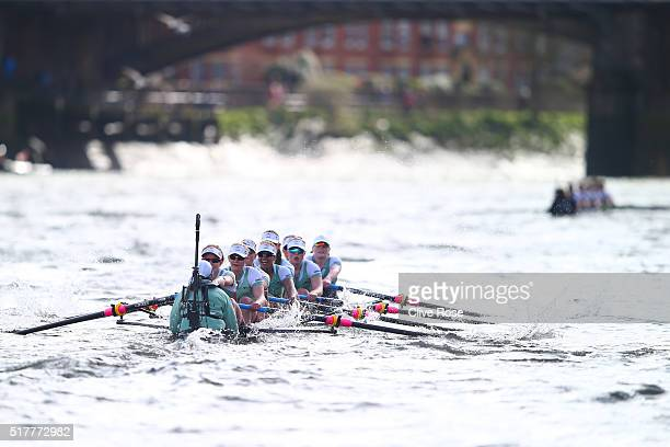 The Cambridge boat lags far behind the Oxford boat during The Cancer Research UK Women's Boat Race on March 27 2016 in London England