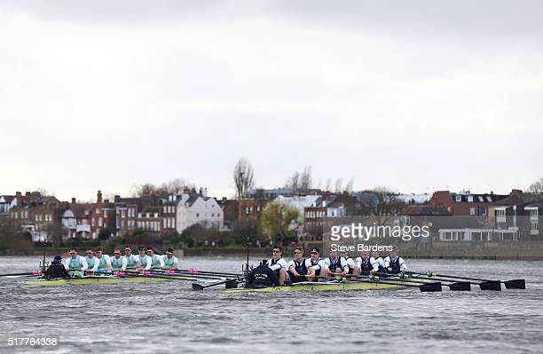 The Cambridge boat leads the Oxford boat during The Cancer Research UK Boat Race on March 27 2016 in London England