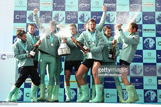 The Cambridge crew celebrates with the trophy following their victory during The Cancer Research UK Boat Race on March 27 2016 in London England