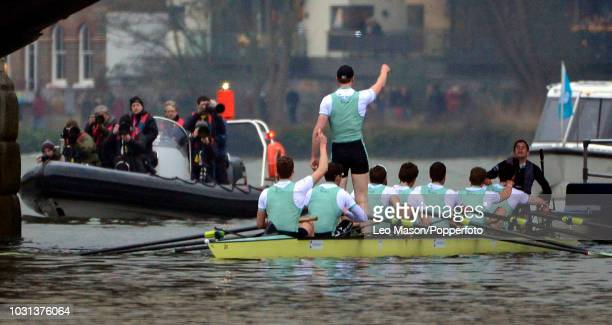 The Cambridge men's crew celebrate winning at the finish after the University Men's Boat Race between Oxford and Cambridge on the River Thames...