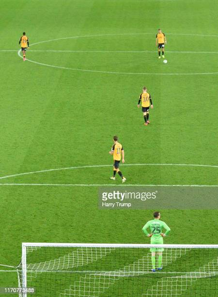 The Cambridge side cut dejected figures after conceding a sixth goal scored by Wayne Routledge of Swansea City during the Carabao Cup Second Round...
