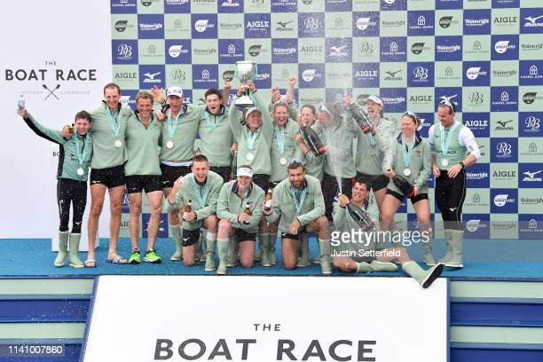 The Cambridge University Boat Club Blue Boat Crew and The Cambridge University Women's Boat Club Blue Boat Crew celebrates after winning the Women's...