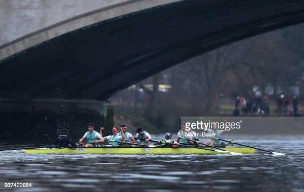 The Cambridge University Men's Boat Club Blue crew celebrate race victory over Oxford University Men's Boat Club Blue crew during The Cancer Research...
