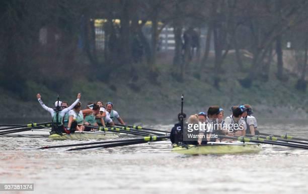 The Cambridge University Women's Boat Club Blue crew celebrate race victory over Oxford University Women's Boat Club Blue crew during The Cancer...