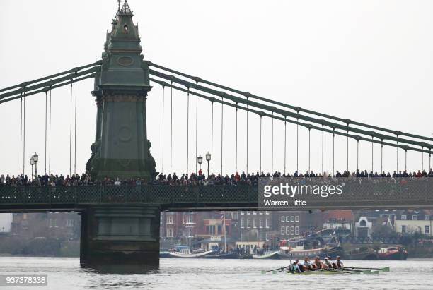 The Cambridge University Women's Boat Club Blue crew pass under Hammersmith Bridge during The Cancer Research UK Women's Boat Race 2018 on March 24,...