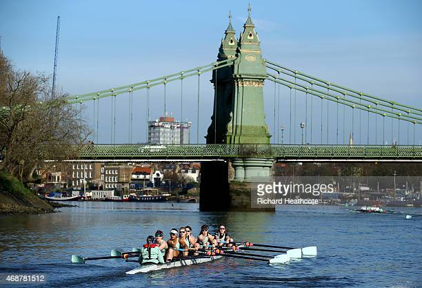 The Cambridge Women's Boat Crew row under Hammersmith Bridge during a training outting ahead of the Newton Women's University Boat Race on The River...