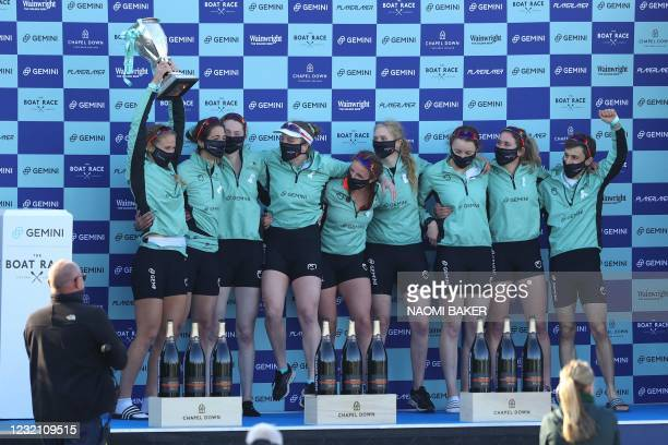 The Cambridge women's crew celebrate at the presentation ceremony for the 75th annual women's boat race between Oxford University and Cambridge...