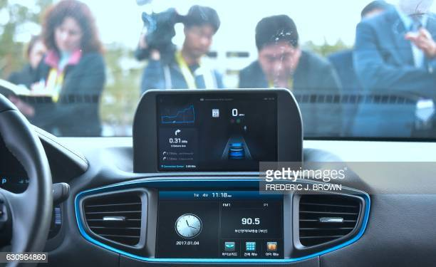 The camera array display is shown on the dashboard of Hyundai's Autonomous IONIQ vehicle as people gather for a view and testride at the 2017...