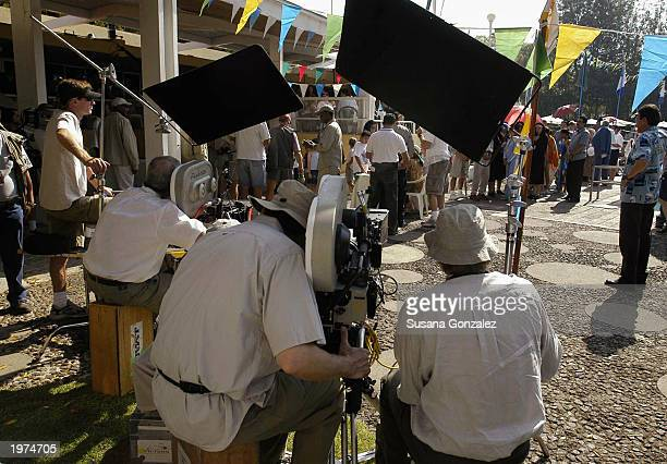 The camera crew films a scene of Man On Fire at a sports club May 5 2003 in Mexico City Mexico