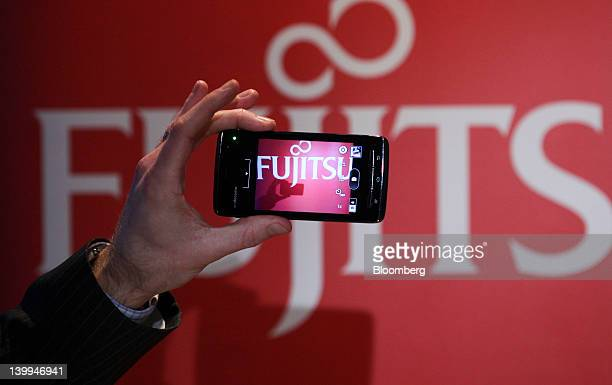 The camera function is displayed on a Fujitsu Ltd F07D Apollo smartphone in this arranged photograph in Barcelona Spain on Sunday Feb 26 2012 The...