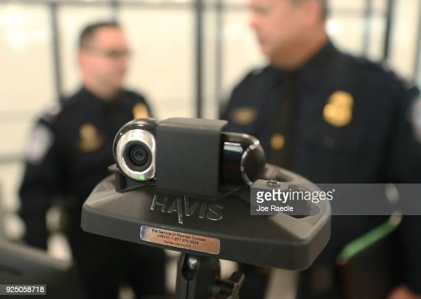 The camera is seen on a facial recognition device as US Customs and Border Protection officers use it Miami International Airport to screen travelers...