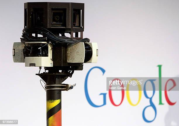 The camera of a German Google Street View car looms over the car next to the Google logo at the Google stand at the CeBIT Technology Fair on March 3,...