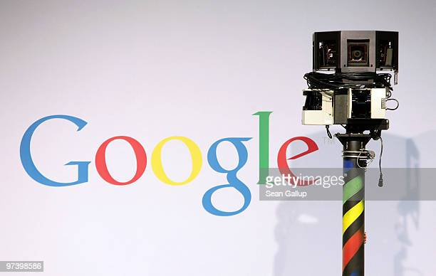 The camera of a German Google Street View car looms over the car next to the Google logo at the Google stand at the CeBIT Technology Fair on March 3...