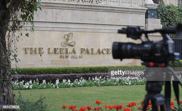 The camera of a television news crew sits on a tripod outside the Leela Hotel where the wife of India's Human Resources Minister Shashi Tharoor...