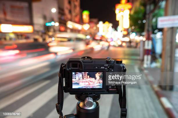 the camera on the background blurry city lights - digital camera stock pictures, royalty-free photos & images