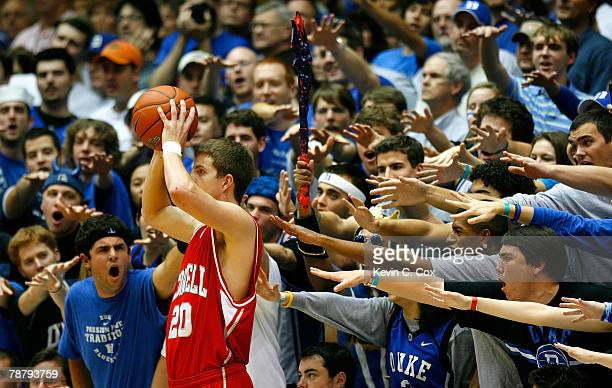 The Cameron Crazies heckle Ryan Wittman of the Cornell Big Red during the game against the Duke Blue Devils at Cameron Indoor Stadium on January 6,...
