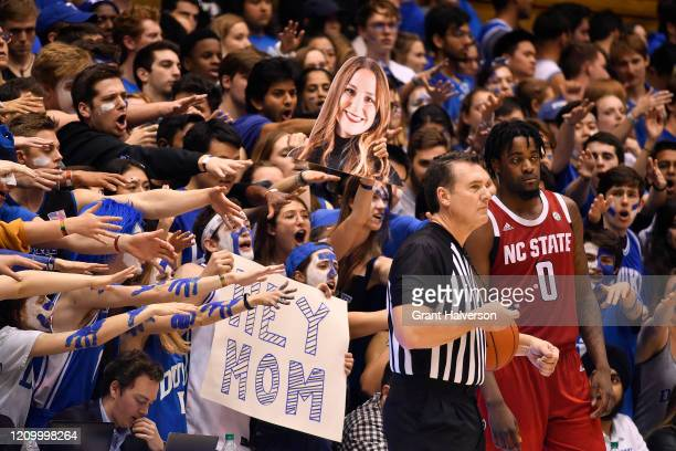 The Cameron Crazies taunt DJ Funderburk of the North Carolina State Wolfpack during the second half of their game against the Duke Blue Devils at...