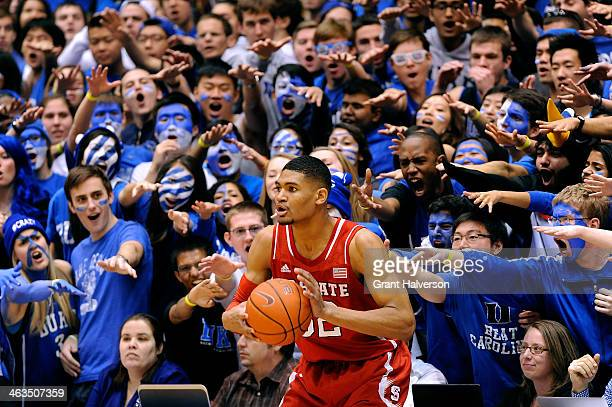 The Cameron Crazies taunt Kyle Washington of the North Carolina State Wolfpack as he prepares to inbound the ball against the Duke Blue Devils during...