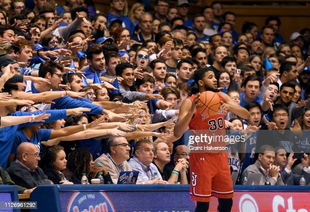 The Cameron Crazies taunt LJ Figueroa of the St John's Red Storm during the second half of their game against the Duke Blue Devils at Cameron Indoor...