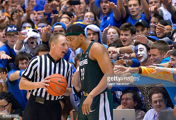 The Cameron Crazies taunt Miles Bridges of the Michigan State Spartans as he talks with official Mike Eades during the game against the Duke Blue...