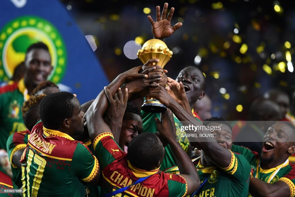 The Cameroon football team celebrate with the winner's trophy after beating Egypt 2-1 to win the 2017 Africa Cup of Nations final football match between Egypt and Cameroon at the Stade de l'Amitie Sino-Gabonaise in Libreville on February 5, 2017. /