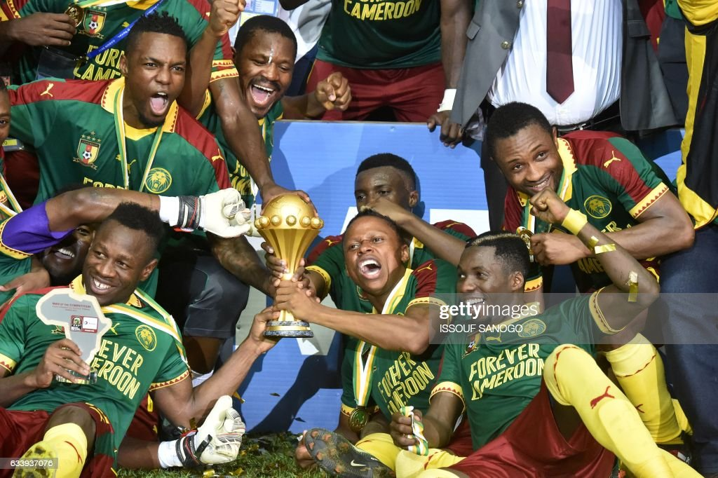 TOPSHOT - The Cameroon football team celebrates with the trophy after beating Egypt 2-1 to win the 2017 Africa Cup of Nations final football match between Egypt and Cameroon at the Stade de l'Amitie Sino-Gabonaise in Libreville on February 5, 2017. /