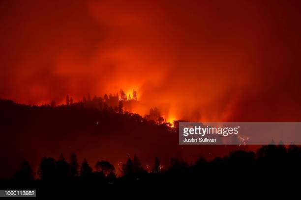 The Camp Fire burns in the hills on November 10 2018 near Ororville California Fueled by high winds and low humidity the Camp Fire ripped through the...