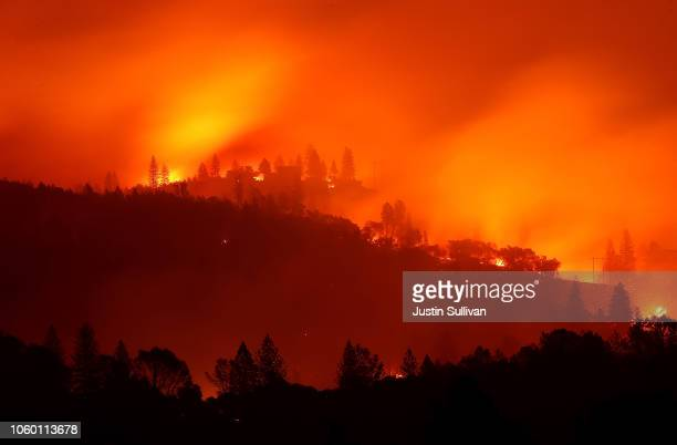 The Camp Fire burns in the hills on November 10 2018 near Oroville California Fueled by high winds and low humidity the Camp Fire ripped through the...