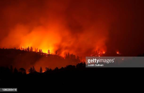 The Camp Fire burns in the hills on November 11 2018 near Oroville California Fueled by high winds and low humidity the Camp Fire ripped through the...