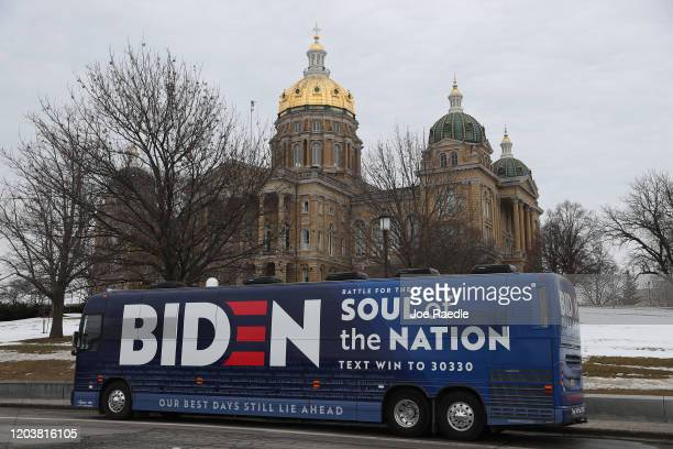 The campaign bus for Democratic presidential candidate former Vice President Joe Biden is seen parked in front of the Iowa State Capitol on February...