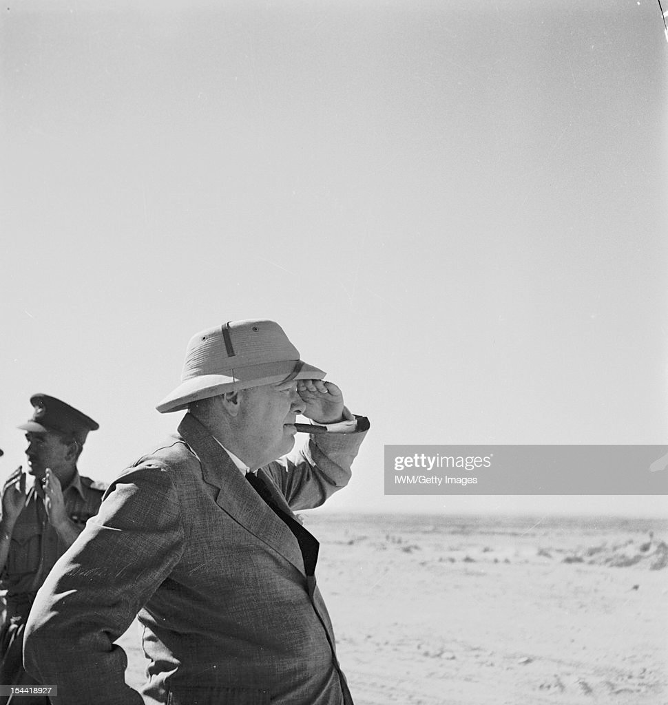 Mr Churchill Visits The Western Desert, Prime Minister, Mr Winston Churchill wearing sun helmet, viewing the Alamein position, 7 August 1942.
