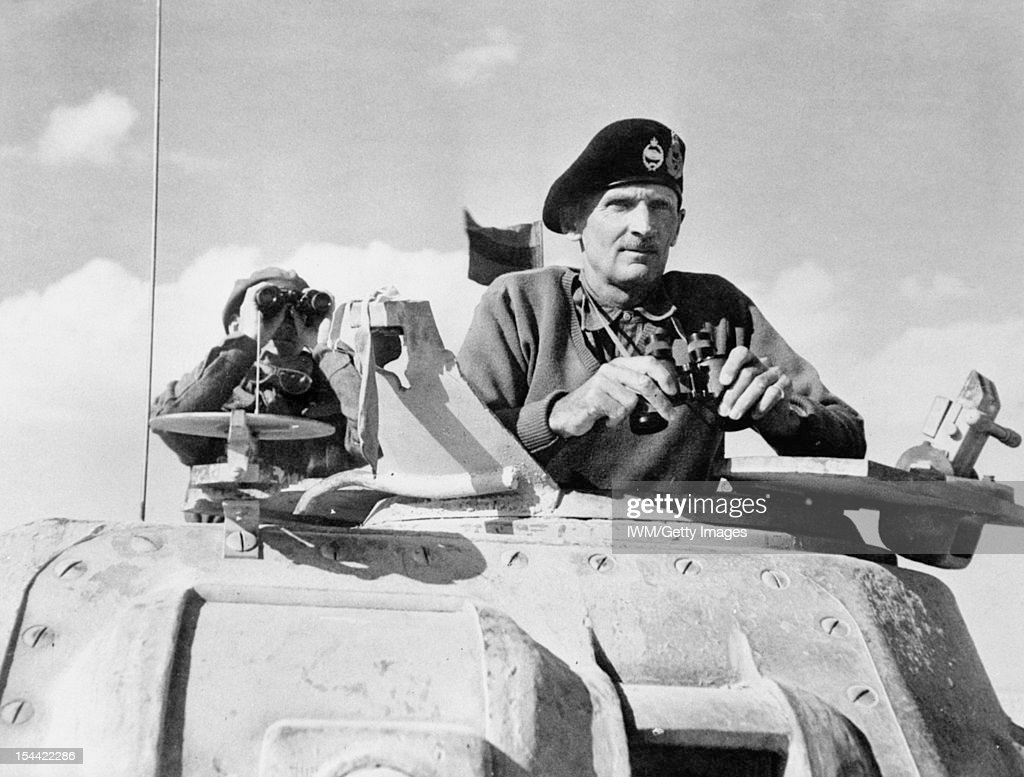Personalities, Lieutenant General B L Montgomery, General Officer Commanding Eighth Army, watches the beginning of the German retreat from El Alamein from the turret of his Grant Tank. He is wearing his famous tank beret, 5 November 1942.