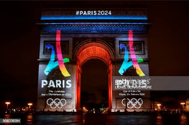 TOPSHOT The campaign's official logo of the Paris bid to host the 2024 Olympic Games is seen on the Arc de Triomphe in Paris on February 9 2016 AFP...