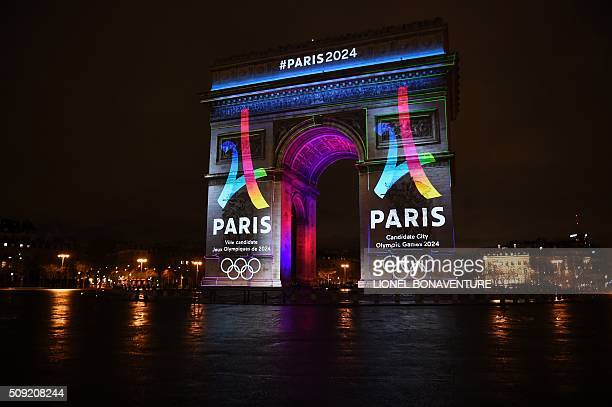 The campaign's official logo of the Paris bid to host the 2024 Olympic Games is seen on the Arc de Triomphe in Paris on February 9 2016 AFP PHOTO /...