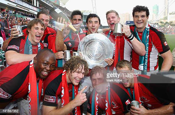 The Canada team celebrate after victory in the Qualifier final match between Spain and Canada on day three of the 2012 IRB Hong Kong Sevens at Hong...