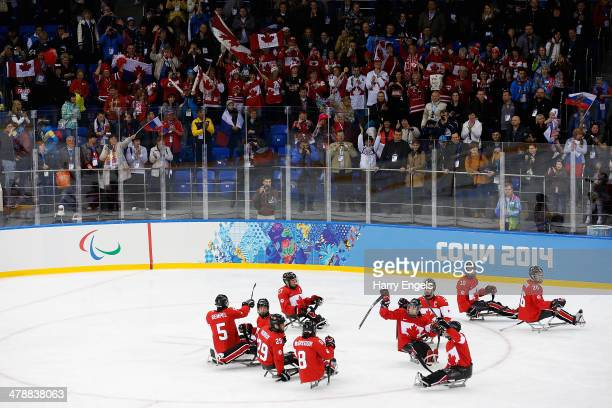 The Canada team celebrates winning the Ice Sledge Hockey Bronze Medal match between Canada and Norway at the Shayba Arena during day eight of the...