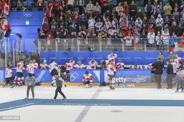 The Canada women's hockey team sits dejected after losing to the US women's hockey team 32 in a shootout following the women's gold medal hockey game...
