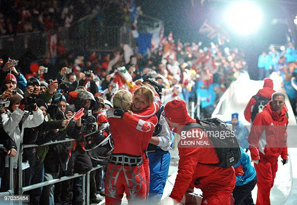 The Canada1 women bobsleigh pilot Kaillie Humphries and brakeman Heather Moyse celebrate winning gold in the twoman bobsleigh event in the Vancouver...