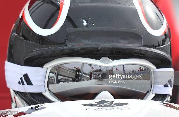 The Canada-2 four-man bobsleigh team piloted by Pierre Lueders start heat 3 of the 4-man bobsleigh event at the Whistler sliding centre during the...