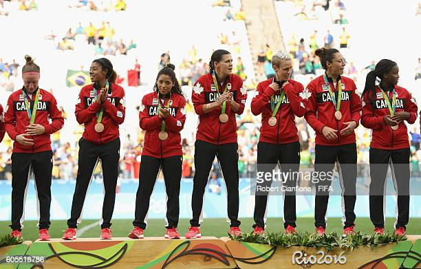 The Canadain team are presented with their bronze medals after the Women's Football Bronze Medal match between Brazil and Canada on Day 14 of the Rio...