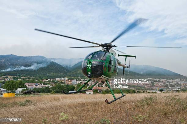 The Canadairs and the Civil Protection and Carabinieri Corps helicopters launch water over the vast fire L'Aquila Italy on August 1 2020