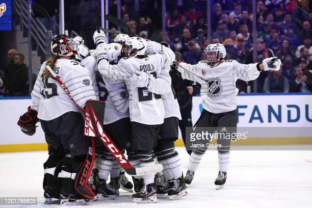 The Canadian All-Stars celebrate against the American All-Stars in the Elite Women's 3-on-3 presented by adidas during the 2020 NHL All-Star Skills...