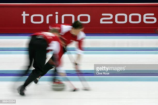 The Canadian curling team in action during the preliminary round of the Men's curling between Canada and Sweden during Day 4 of the Turin 2006 Winter...