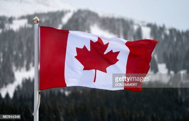 The Canadian flag flies over the Lake Louise ski lodge in the Canadian Rockies November 29 2017 in Lake Louise Alberta EMMERT