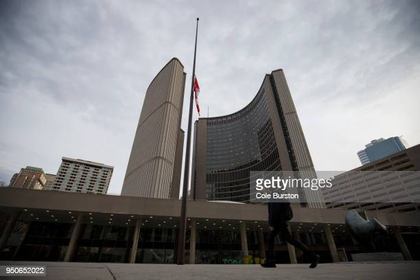 The Canadian flag hangs at half mast in front of Toronto City Hall on April 24 2018 in Toronto Canada A suspect identified as Alek Minassian is in...